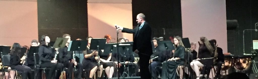 Mr. A conducts the Wind Ensemble